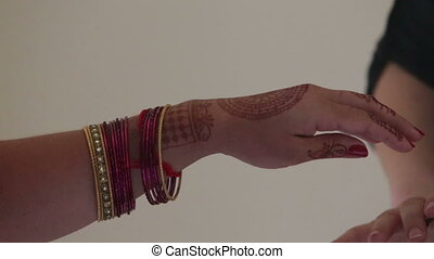 indian woman dress on bracelet