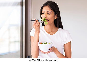indian woman eating green salad