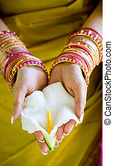 indian woman holding a white flower