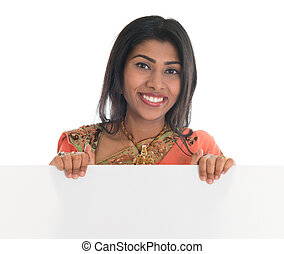 Indian woman holding blank billboard