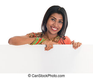 Indian woman holding blank placard