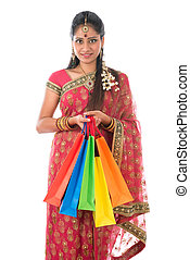 Indian woman holding shopping bags
