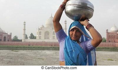 Indian Woman In Front of Taj Mahal