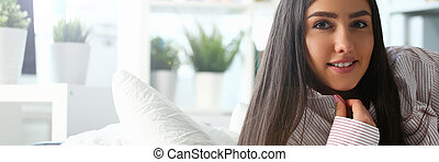 Indian woman in male shirt at home