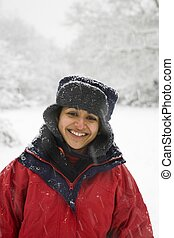 Indian woman in snow covered woods