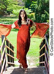 indian woman on bridge
