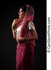 Indian woman on grey