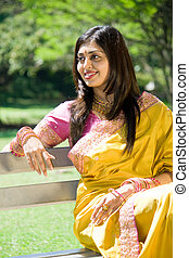 indian woman relaxing in park