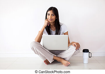indian woman relaxing on the floor