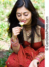 indian woman smelling flowers