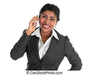 Indian woman talking on phone.