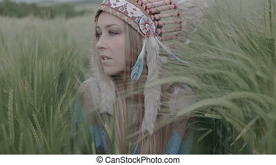 Indian woman walking in the field - Closeup of Native...