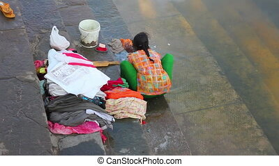 Indian woman washing clothes in the lake