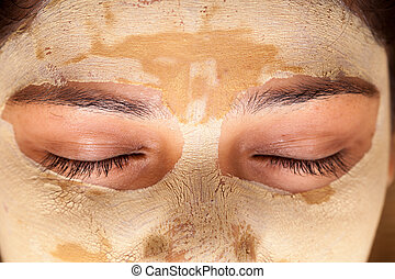 Indian woman with face mask - Close up of beautiful indian...