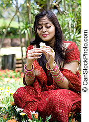indian woman with flowers