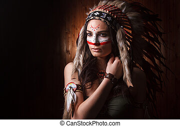 Indian woman with traditional make up and headdress looking ...