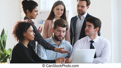 Indian worker offering creative online project idea during team discussion