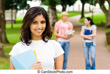 indian young adult - a young lovely indian woman in front of...