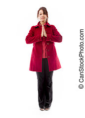 Indian young woman standing in prayer position