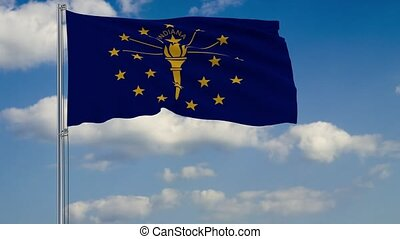 Indiana State flag in wind against cloudy sky - Flag of...