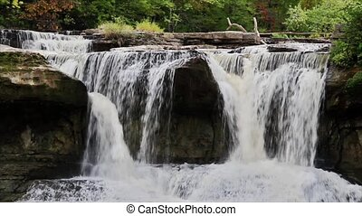Indiana Waterfall Loop - Water pours through boulders and...