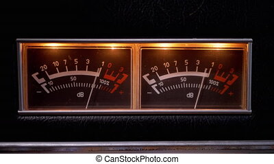 Indicator Arrows, Illuminated Decibel Meters on Dial Vintage Stereo Amplifier. Old dual analogue scale audio level meter. Retro power amplifier. High-quality sound disco, club, home. Close-up. 4K
