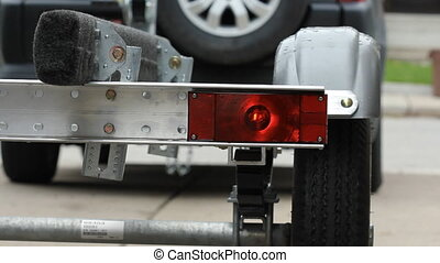 Indicator light on trailer. - Blinking indicator light on...