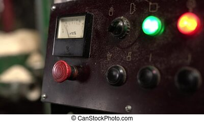 Indicator needle moves during operation of machine, close-up