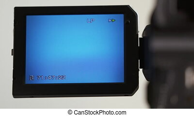 Indicators on LCD screen of digital camcorder while...