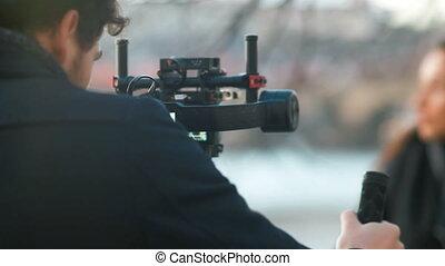 Indie Filmmaker Working with his Model - Caucasian man...
