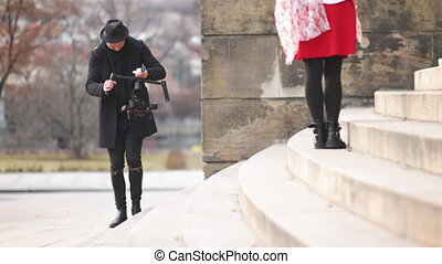 Indie Filmmaker Working With Model - Camera operator looking...