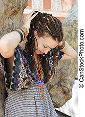Indie style woman with dreads