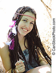 Indie style young woman with dreadlocks portrait, outdoor in autumn park