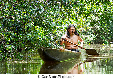 Indigenous Adult Man In Wooden Canoe