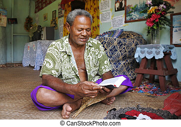 Indigenous Fijian man reads the bible in Fiji - Indigenous...