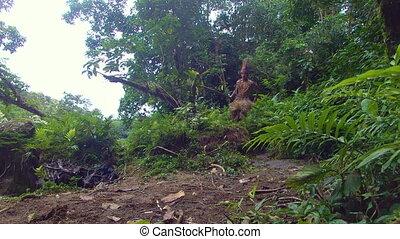 Indigenous Hunter Running Through The Amazon Rainforest - ...