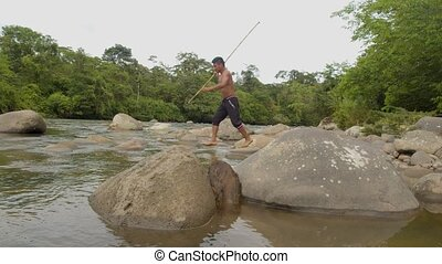 Indigenous Hunter Trying To Fish With A Spear In The Amazon ...