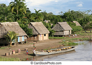 Indigenous Village and Boat - An indigenous village in the...