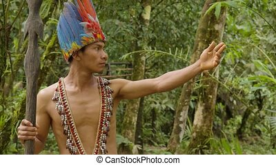 Indigenous Warrior Showing The Viewer The Amazon Rainforest ...