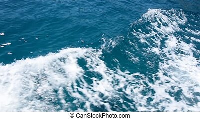 Indigo blue sea water waves running aboard of boat - Close...