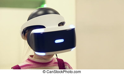 Individual 3D display virtual reality on a head of a girl