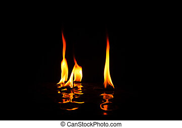 Individual flames of fire with reflection