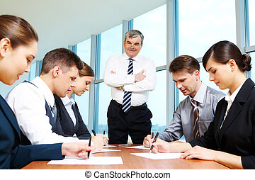 Individual work - Confident boss looking at managers while...