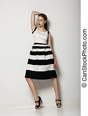 Individualism. Confident Young Woman in Contrast Light Sundress