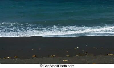 """""""Indonesia, Bali. Beach with black sand and garbage from..."""