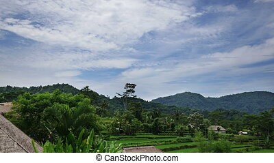 Indonesia, Bali, clouds move over the mountain and rice terraces,Time lapse,