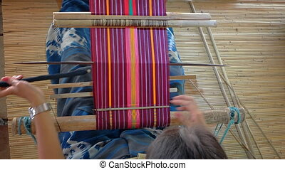 Indonesia, Bali. Local weaver makes tapestry manually.