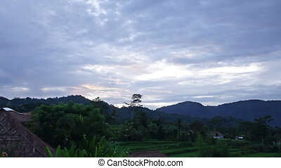 Indonesia, Bali, morning sunrise over the mountain and rice terraces,Time lapse