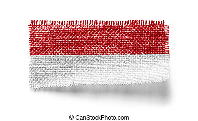 Indonesia flag on a piece of cloth on a white background