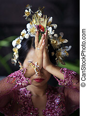 Indonesian bride prays
